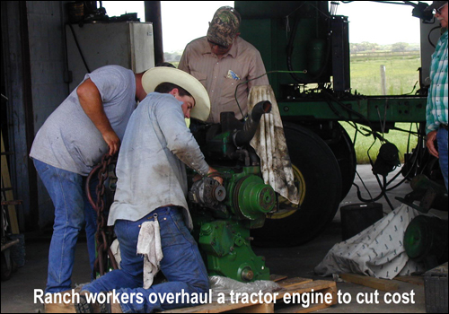 ranch workers overhauling tractor engine